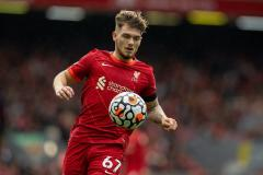 Harvey Elliott playing for Liverpool in a Premier League game against Burnley at Anfield in 2021