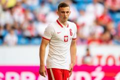 Kacper Kozlowski playing for Poland in a friendly against Iceland in 2021