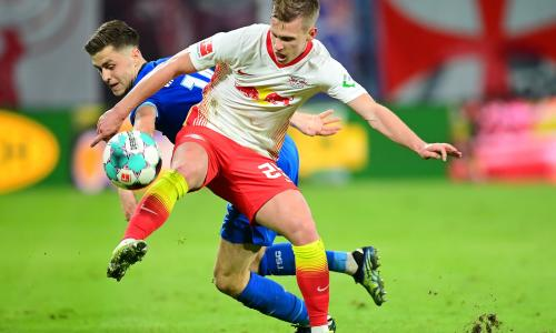 Dani Olmo holds up the ball for RB Leipzig in the Bundesliga