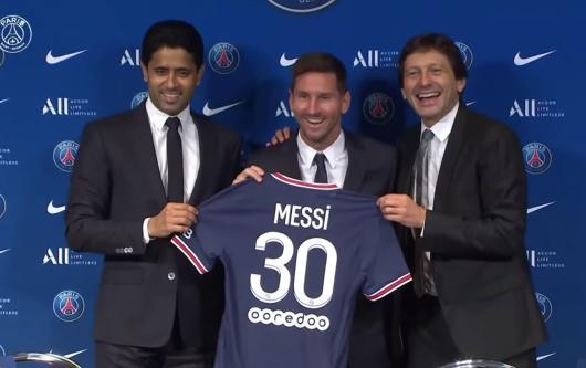 Lionel Messi at his PSG presentation with Nasser Al-Khelaifi and Leonardo