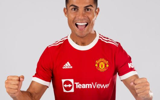 Cristiano Ronaldo poses in the Manchester United home kit for the 2021/22 season