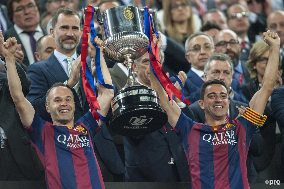 Andres Iniesta and Xavi lift trophy together for Barcelona