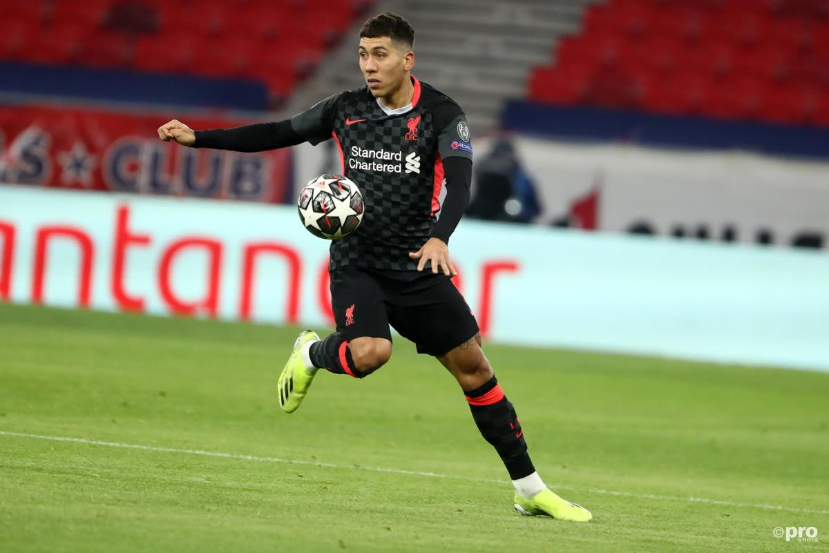 Roberto Firmino controls the ball for Liverpool against RB Leipzig in the UEFA Champions League Round of 16 at the Puskas Arena in 2021