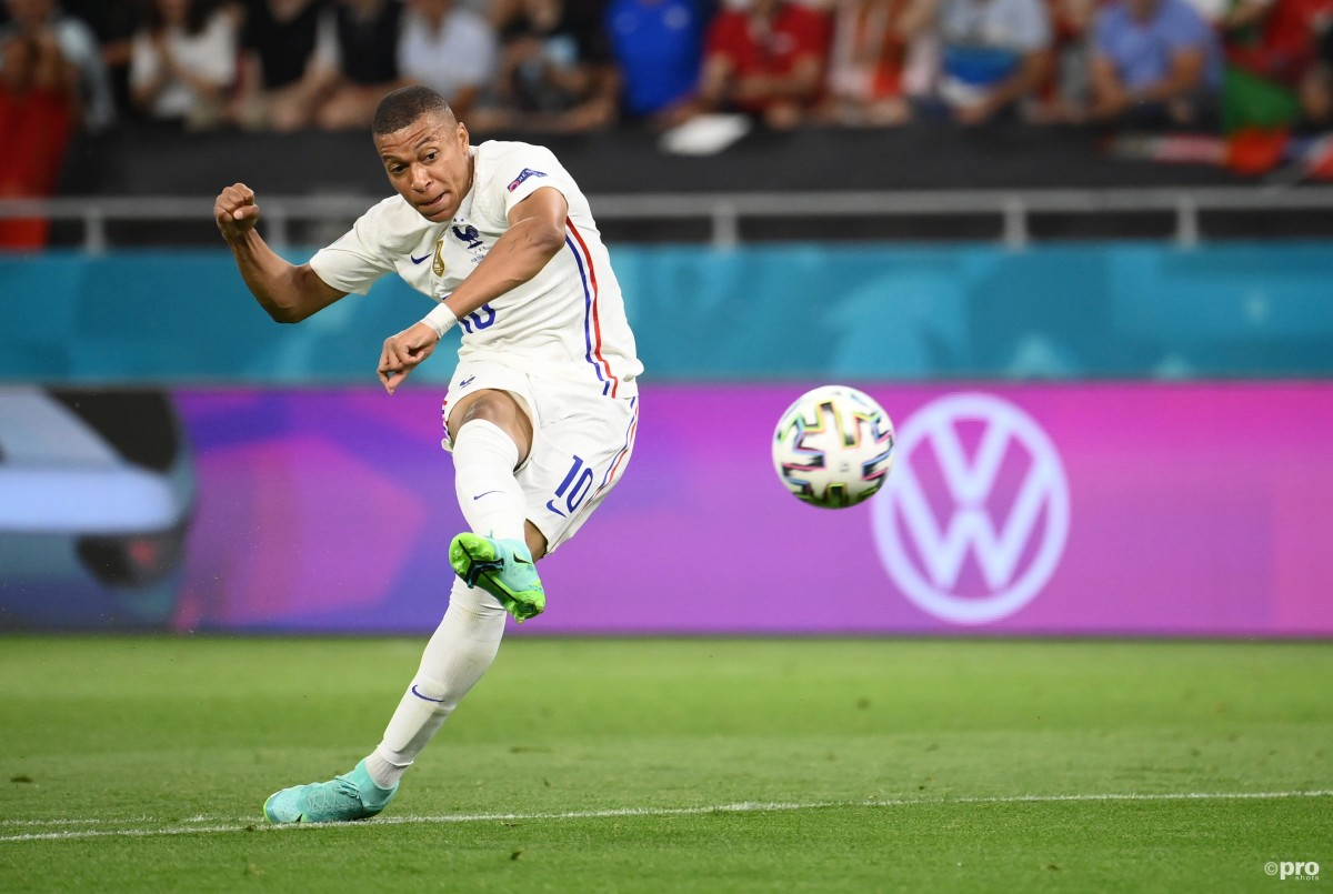 PSG striker Kylian Mbappe shoots towards goal in France's Euro 2020 match with Portugal