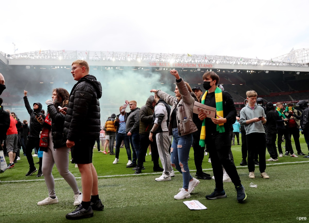 Man Utd-Liverpool game called off as hundreds of home fans break into Old Trafford, storm pitch & stop players leaving hotel